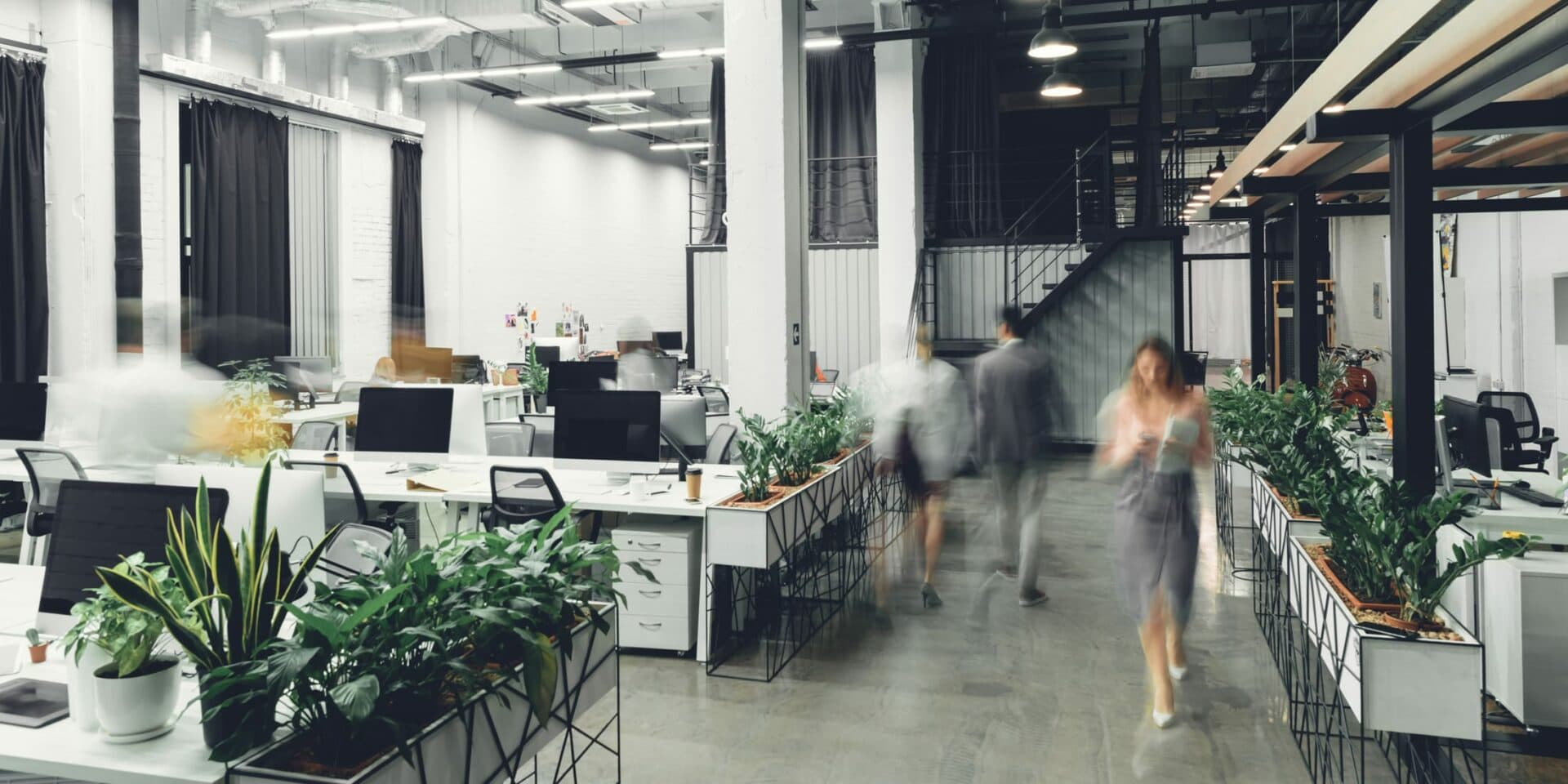 Open space office with walking workers