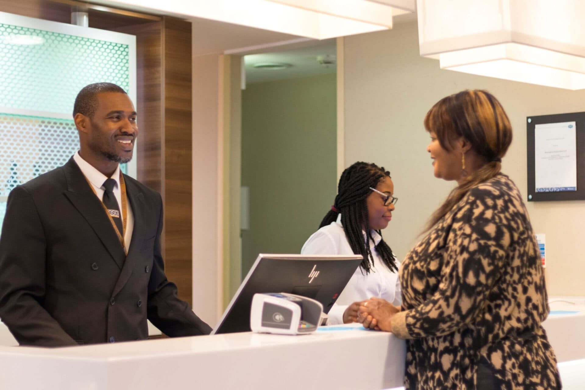 Woman at reception desk talking to concierge