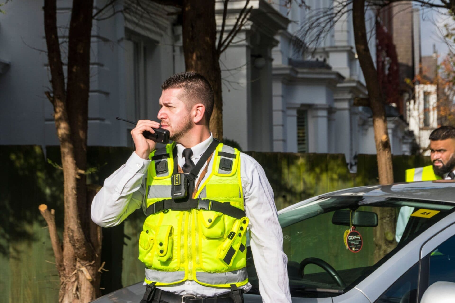 Security guard talking into walkie talkie